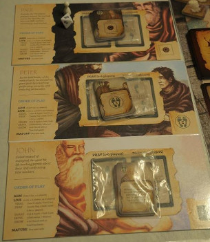 A close-up of the player boards from an advanced prototype of Commissioned.